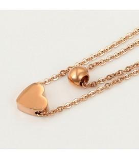 Szív és gömb acél ékszerszett, rozé arany bevonattal